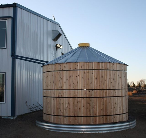 Corrugated Steel Rainwater Tank Wrapped in Cedar